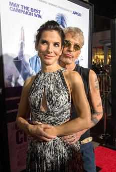 Cast members Sandra Bullock and Billy Bob Thornton pose at the premiere of