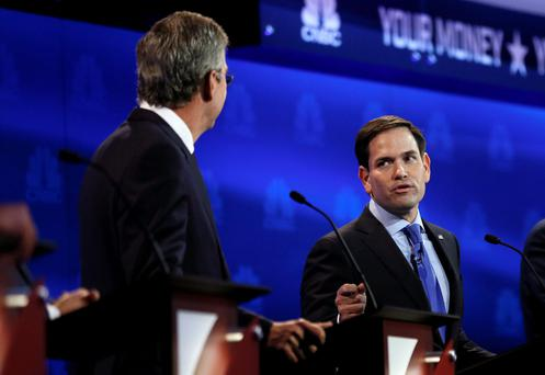 Marco Rubio (right) goes on the attack against his former mentor Jeb Bush (left) in the TV debate. Photo: Reuters