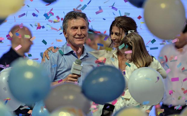 Mauricio Macri (left), celebrates with his wife Juliana Awada and daughter Antonia after his victory in the Argentinian presidential election