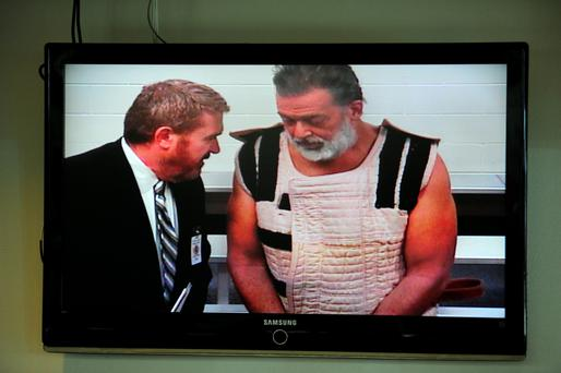 Colorado Springs shooting suspect, Robert Dear, right, appears via video before Judge Gilbert Martinez, with public defender Dan King, at the El Paso County Criminal Justice Center