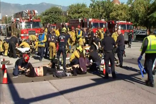 Rescue crews tend to the injured following a shooting incident