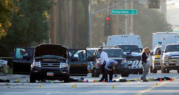 CARNAGE: Forensics at the scene of the San Bernardino, California shooting, where 14 people were shot dead