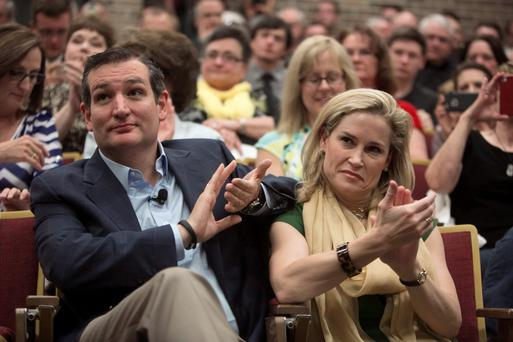 US Senator Ted Cruz and wife Heidi applaud at Morningside College in Sioux City, Iowa