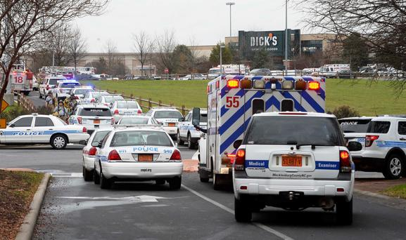Police and paramedics rush to the scene at Northlake Mall in North Carolina. Photo: Robert Lahser/The Charlotte Observer