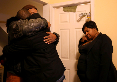 Family members comfort one another after Bettie Jones (55) was shot dead Photo: AP