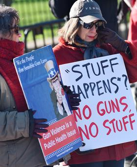 Demonstrators take part in a rally to demand sensible gun laws in front of the White House, as US President Barack Obama was expected to announce measures aimed at curbing gun violence. Photo: AFP/Getty Images