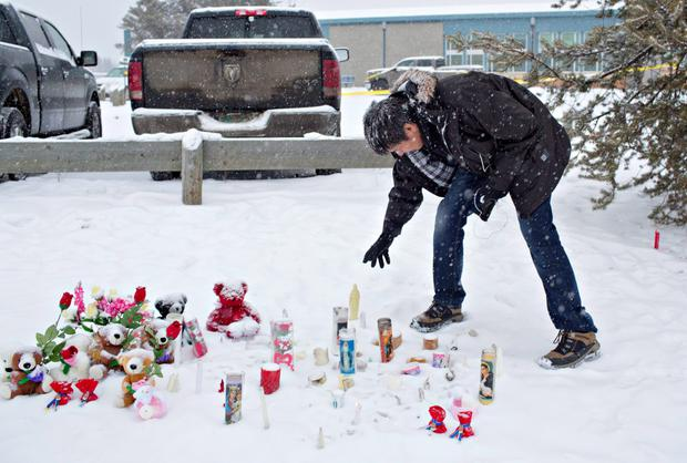 A man lays a tribute at the scene of the shootings in La Loche Photo: AP