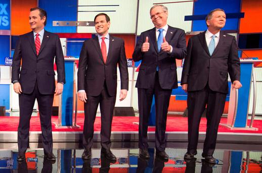Republican Presidential candidates (L-R) Texas Senator Ted Cruz, Florida Senator Marco Rubio, former Florida Gov. Jeb Bush, and Ohio Gov. John Kasich arrive for the Republican Presidential debate sponsored by Fox News at the Iowa Events Center in Des Moines, Iowa on January 28, 2016. / AFP / AFP PHOTO / Jim WATSONJIM WATSON/AFP/Getty Images