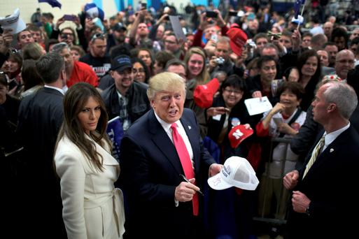 Republican presidential candidate Donald Trump and his wife Melania Trump at a campaign rally at the Gerald W Kirn Middle School in Council Bluffs, Iowa, ahead of the crucial caucus vote last night. Photo: Christopher Furlong/Getty Images