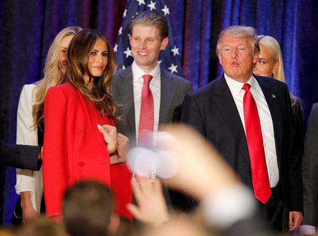 Republican U.S. presidential candidate Donald Trump makes a face as he and his wife Melania and members of their family leave the stage at his caucus night rally in Des Moines, Iowa.