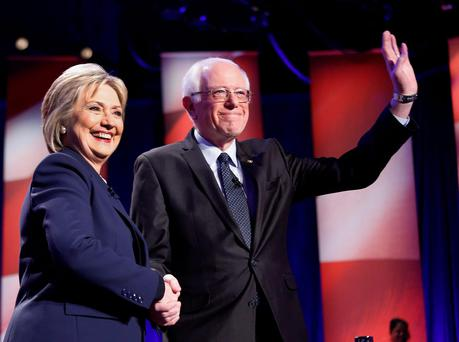 Democratic presidential candidates Hillary Clinton, left, and Sen. Bernie Sanders, I-Vt, pose for a photo before debating at the University of New Hampshire .