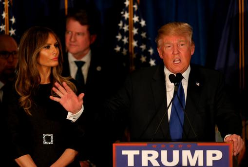 Republican presidential candidate Donald Trump speaks as his wife Melania looks on at his election night watch party in Manchester, New Hampshire. Photo: Joe Raedle/Getty