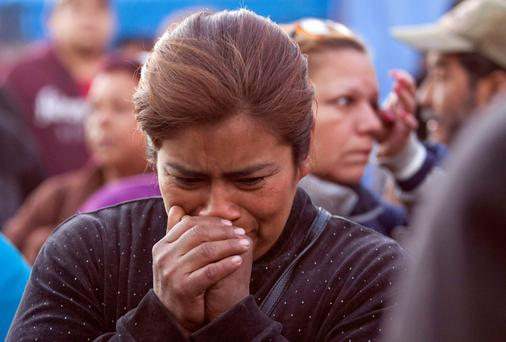 Distraught relatives of inmates gather outside Topo Chico prison in Monterrey, Mexico, scene of a battle between drug gangs