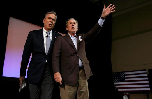 Republican presidential candidate Jeb Bush (left) with his brother, former president George W Bush, campaigning in South Carolina. Photo: Reuters