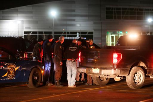 Police involved in the search for the gunman. Photo: AP