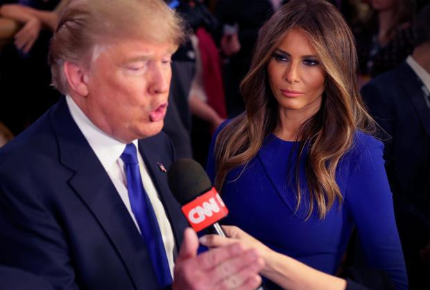 Donald Trump with his wife Milania following a debate in Detroit