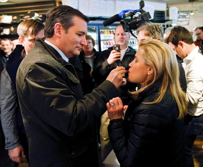 Ted Cruz gives some ice cream to his wife Heidi during a campaign stop in Milwaukee. Photo: Kamil Krzaczynski