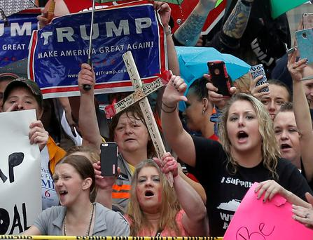 Donald Trump supporters protest outside a campaign event for Hillary Clinton in West Virginia