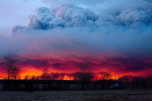 A wildfire moves towards the town of Anzac from Fort McMurray, Alberta. Photo: AP