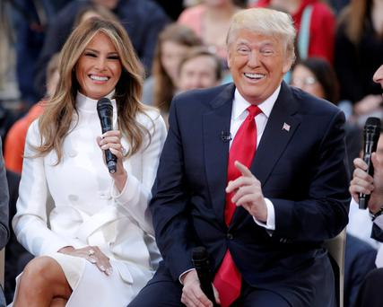 Republican presidential candidate Donald Trump reacts to an answer his wife Melania gives during an interview on NBC's