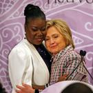 Hillary Cinton embraces Sybrina Fulton, mother of shooting victim Trayvon Martin. Photo: AP