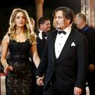 Amber Heard and Johnny Depp who are divorcing.