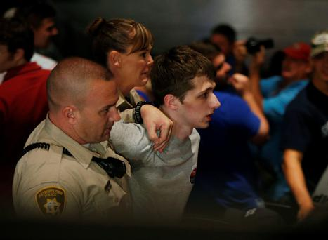 Police remove Michael Sandford as presidential candidate Donald Trump speaks at a casino in Las Vegas. Photo: AP