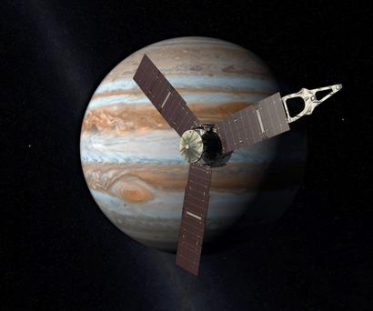 An artist's rendering shows the Juno spacecraft above Jupiter, as it is about to go into orbit around the planet.