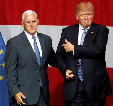 Pence and Donald Trump on Tuesday.Photo: Reuters