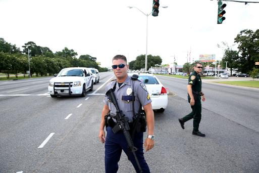 Police officers block off a road after the killings of their colleagues in Baton Rouge, Louisiana. Photo: Joe Penney