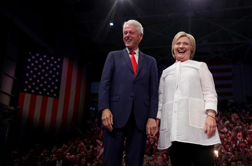 Team effort: Bill's role is to bring some of the warmth and panache that Hillary lacks