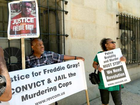 Protesters outside a Baltimore, Maryland court house at the trial of a police officer for his role in events that led to the death of Freddie Gray, a black man whose death in police custody last year sparked riots in the city. Photo: Michael Mathes/Getty