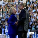 US President Barack Obama is joined by US Democratic presidential candidate Hillary Clinton after his address to the Democratic National Convention at the Wells Fargo Center in Philadelphia, Pennsylvania. Photo: AFP/Getty Images
