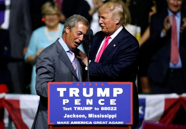 Donald Trump, right, greets former UKIP leader Nigel Farage at a rally in Jackson, Mississippi. Photos: Jonathan Bachman/Getty