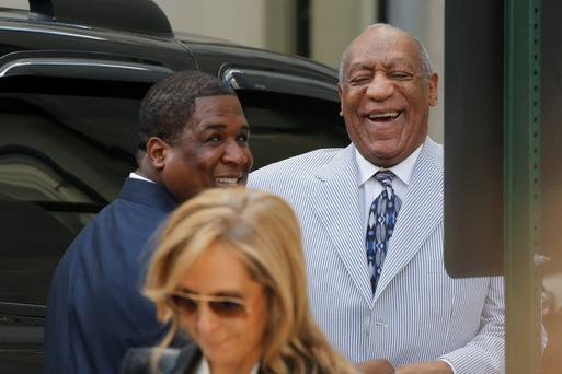 Bill Cosby laughs as he arrives in court for a pretrial conference related to charges stemming from an alleged encounter with Andrea Constand. Photo: Getty