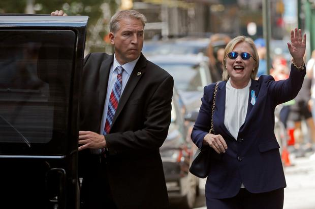 Hillary Clinton leaves her daughter's home in New York after feeling unwell at the 9/11 memorial at the weekend