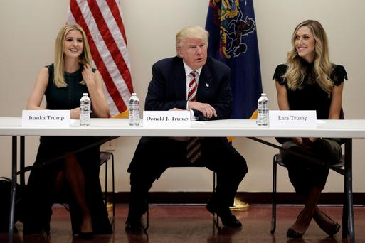 Donald Trump with his daughter Ivanka, left, and daughter-in-law Lara Trump at a meeting on child care issues before a campaign event in Aston, Pennsylvania. Photo: Mike Segar/Reuters