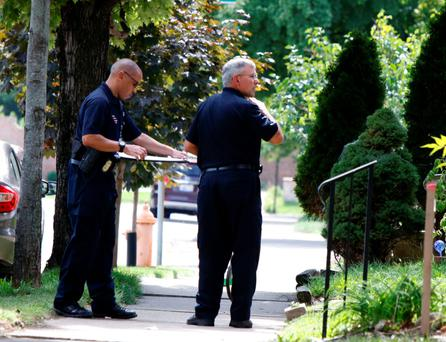 Police officers near the scene of the shooting