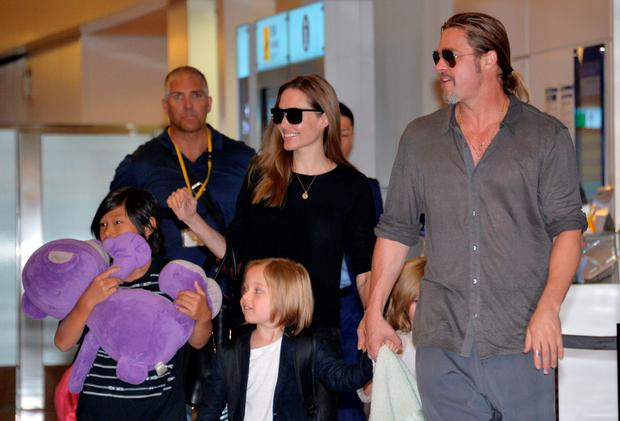 US film stars Brad Pitt (right) and Angelina Jolie (centre), accompanied by their children, as they arrive at Haneda International Airport in Tokyo in 2013. Photo: Yoshikazu Tsuno/AFP/Getty Images