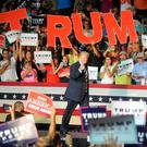 Donald Trump walks on stage to a rapturous welcome at a campaign event in Roanoke, Virginia, at the weekend. REUTERS