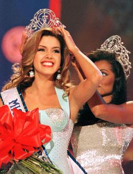Alicia Machado smiles after winning the 1996 ''Miss Universe'' crown