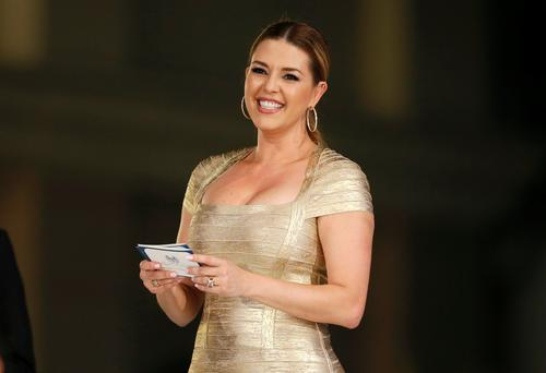 Venezuelan-born former Miss Universe Alicia Machado, who was the subject of criticism over Twitter by Republican presidential candidate Donald Trump, presents an award at the Metropolitan Fashion Week's closing gala in Burbank, California. Photo: Getty