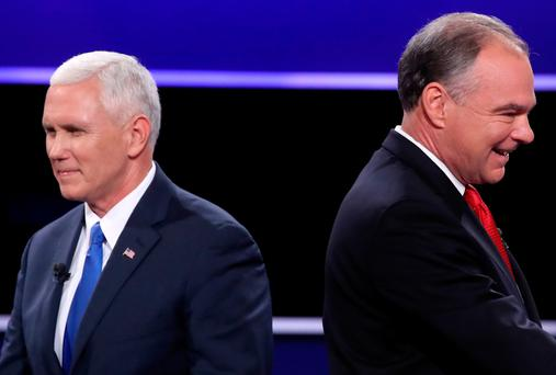 Republican vice presidential nominee Mike Pence and Democratic vice presidential nominee Tim Kaine stand on stage following the Vice Presidential Debate at Longwood University in Farmville, Virginia. Photo: Mark Wilson/Getty Images
