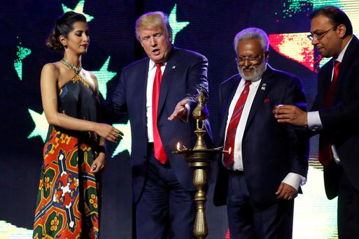 Donald Trump appears on stage to light a ceremonial diya lamp before he speaks at a Bollywood-themed charity concert put on by the Republican Hindu Coalition in Edison, New Jersey. Photo: Reuters
