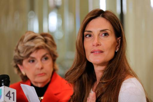 Karena Virginia (right) speaks to the media as she identifies herself as victim of sexual misconduct by Republican Presidential candidate Donald Trump. Photo: Getty Images