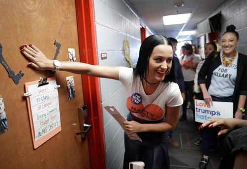 Singer Katy Perry knocks on a dorm room door while canvassing for Hillary Clinton at a university in Las Vegas Photo: AP