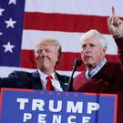 Republican presidential nominee Donald Trump is introduced by former Indiana University basketball coach Bobby Knight during a campaign rally at the Deltaplex Arena in Grand Rapids, Michigan on Monday. Photo: Chip Somodevilla/Getty Images