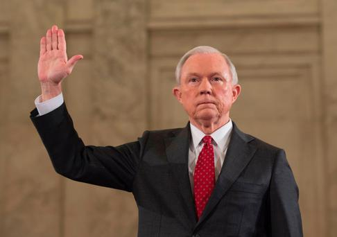 Jeff Session raises his hand as he is sworn in before the Senate Judiciary Committee during his confirmation hearing to be US Attorney General in January