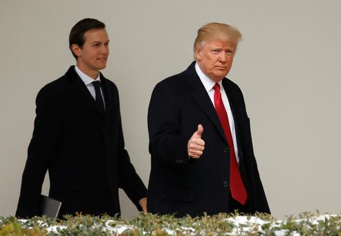 President Donald Trump and son-in-law Jared Kushner, his senior adviser, leave the White House in Washington yesterday. Photo: Reuters