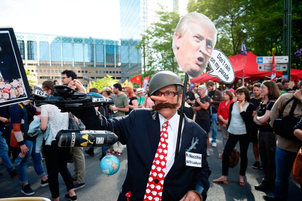 A protester in Brussels ahead of Mr Trump's visit. Photo: Getty